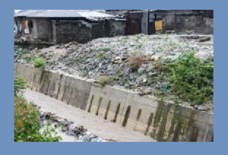Illegal dumpsites siting by fast moving storm drains that take the waste out to sea including plastic