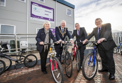 Cllr John Pritchard, Cllr David A Bithell, FCC Environment Contract Manager Mac Kenrick and Eluned Griffiths, sampling bikes at the new Re-use store
